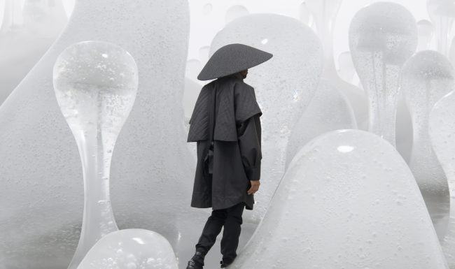 surreal image illustration of a man walking through water bubbles