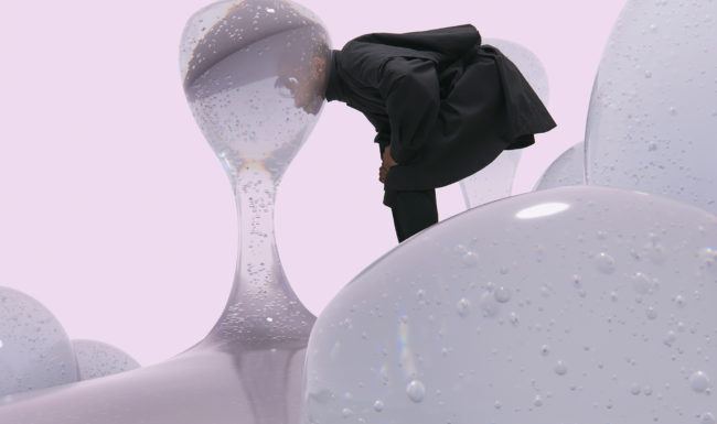 surreal image illustration of mand with his head in a bubble